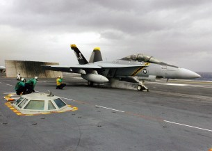 """A US Navy (USN) F/A-18F Super Hornet aircraft assigned to the """"Jolly Rogers"""" of Strike Fighter Squadron 103 (VFA-103), prepares to launch from the flight deck of the USN Nimitz Class Aircraft Carrier, USS DWIGHT D. EISENHOWER (CVN 69). The EISENHOWER and Carrier Air Wing 7 (CVW-7) are underway conducting a Tailored Ship's Training Availability/Final Evaluation Period in the Atlantic Ocean."""