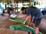 Cutting banana leaves for steaming Lanna bread