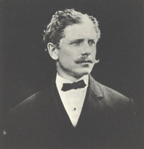 Formal black and white portrait of a man, Ambrose Bierce, in tuxedo.
