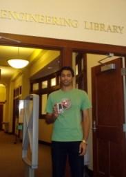 Aravind Ranganathan poses with his prize, an iPod nano