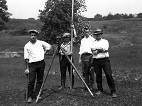 Men with Surveying Equipment