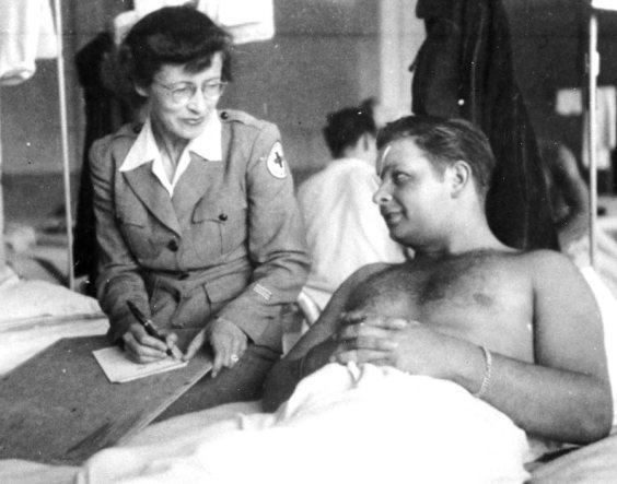 Barbara Lincoln Ashbaugh writing for a patient, Tongres, Belgium ca. 1945