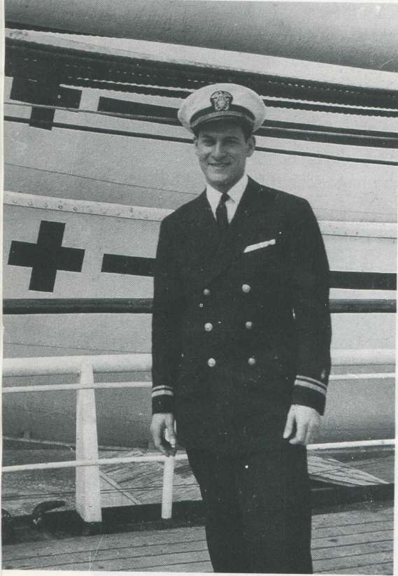 Dr. Heimlich in front of the hospital ship Repose