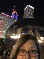 Kellie Tilton taking a photo in front of the Bean.