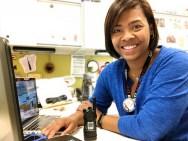Michelle sitting at her desk