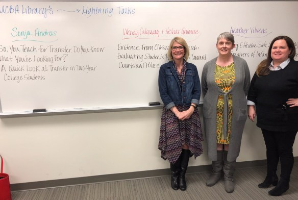 Faculty Presenters standing in front of white board.