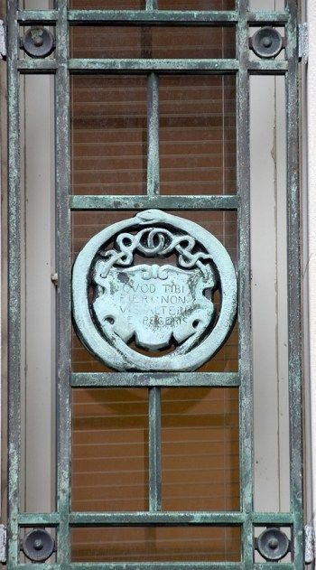 Ouroboros in Blegen Library window grill