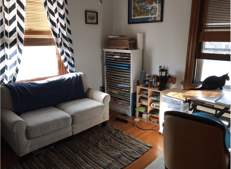 studio with couch and craft supplies
