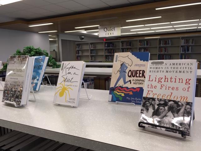 book display atop bookshelves