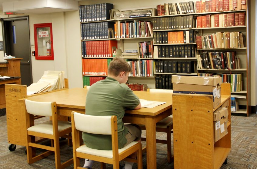 student researching in the archives and rare books library