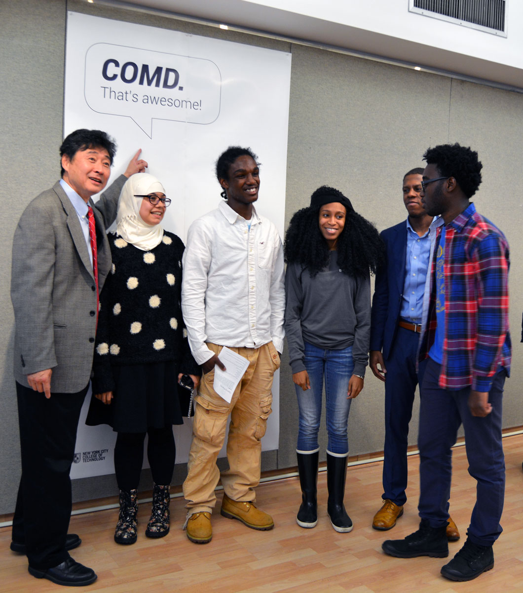 COMD Students and the Dean of Tech & Science goofing off at the ribbon cutting.