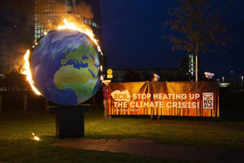 A model planet Earth was set on fire in front of the ECB headquarters in Frankfurt.