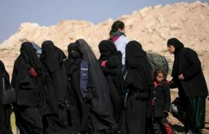 Hundreds limp out of besieged ISIS enclave in Syria