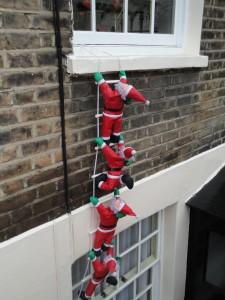 Town Mouse does climbing Santas