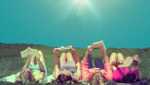 favourite books and readers on beach