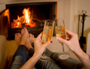 Couple Drinking Champagne In Front Of A Fire