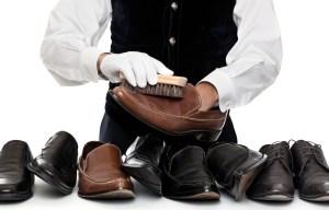 butler polishing shoes