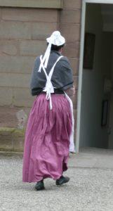female servant in Regency costume