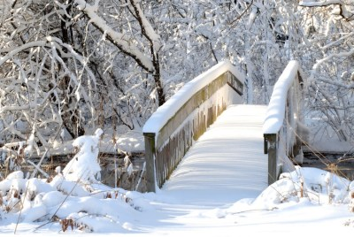 snow covered bridge beckons across to sunshine