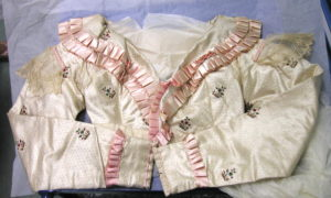 cream satin spencer with pink ruched decoration