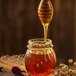 pot of golden honey and honey server