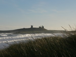 Dunstanburgh Castle and rolling waves