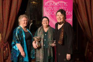 Jane Godman winner Libertà shorter romantic novel award 2019 and Betty Neels trophy with Libertà's Sophie Weston and Joanna Maitland
