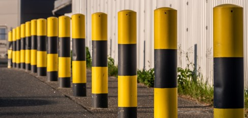 yellow bollards, repetition concept