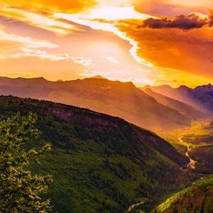 A sunset above a mountainous landscape