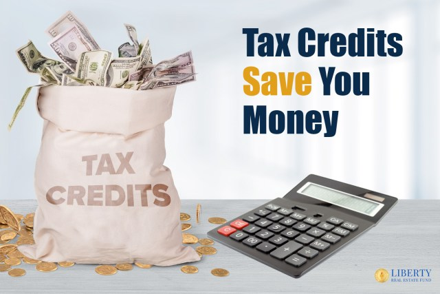 """A bank money bag with """"TAX CREDITS"""" written on it with $ sticking out top and sitting on a small mound (small hill or pile) of coins. Next to calculator. Title text above calculator """"Tax Credits Save You Money"""""""
