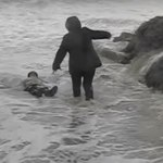 VIDEO: Elderly Couple Swept Away By Wave…Saved By Bystander