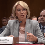 While DeVos Talks School Safety, Media and Dems Focus on Guns