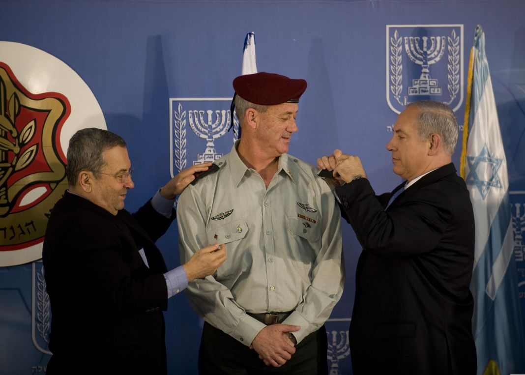 Israeli Prime Minister Benjamin Netanyahu, right, and Defense Minister Ehud Barak, left, take part in a ceremony formally promoting Maj. Gen. Benny Gantz, center, to lieutenant general and making him the 20th chief of the general staff of the Israel Defense Forces Feb. 14, 2011, at the prime minister's office in Jerusalem. U.S. Chairman of the Joint Chiefs of Staff Navy Adm. Mike Mullen was among the guests in attendance. (U.S. Army photo by Staff Sgt. Teddy Wade/Released)