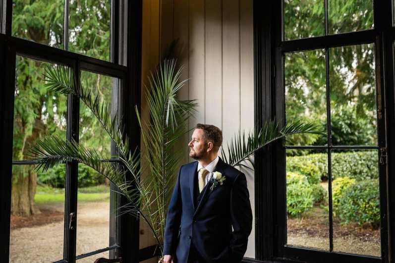 Groom awaits the bride at Larmer tree Gardens