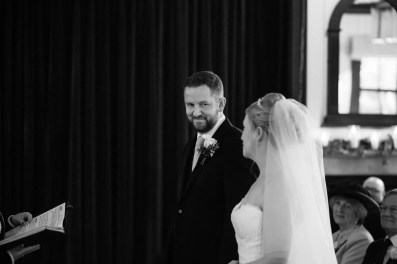 A knowing look from the groom to his bride at Larmertree gardens