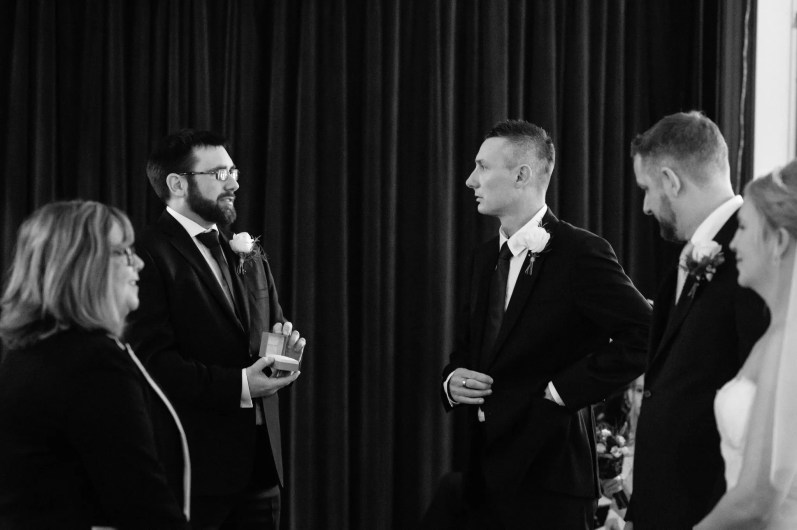 Best man opens an empty ring box during the wedding ceremony
