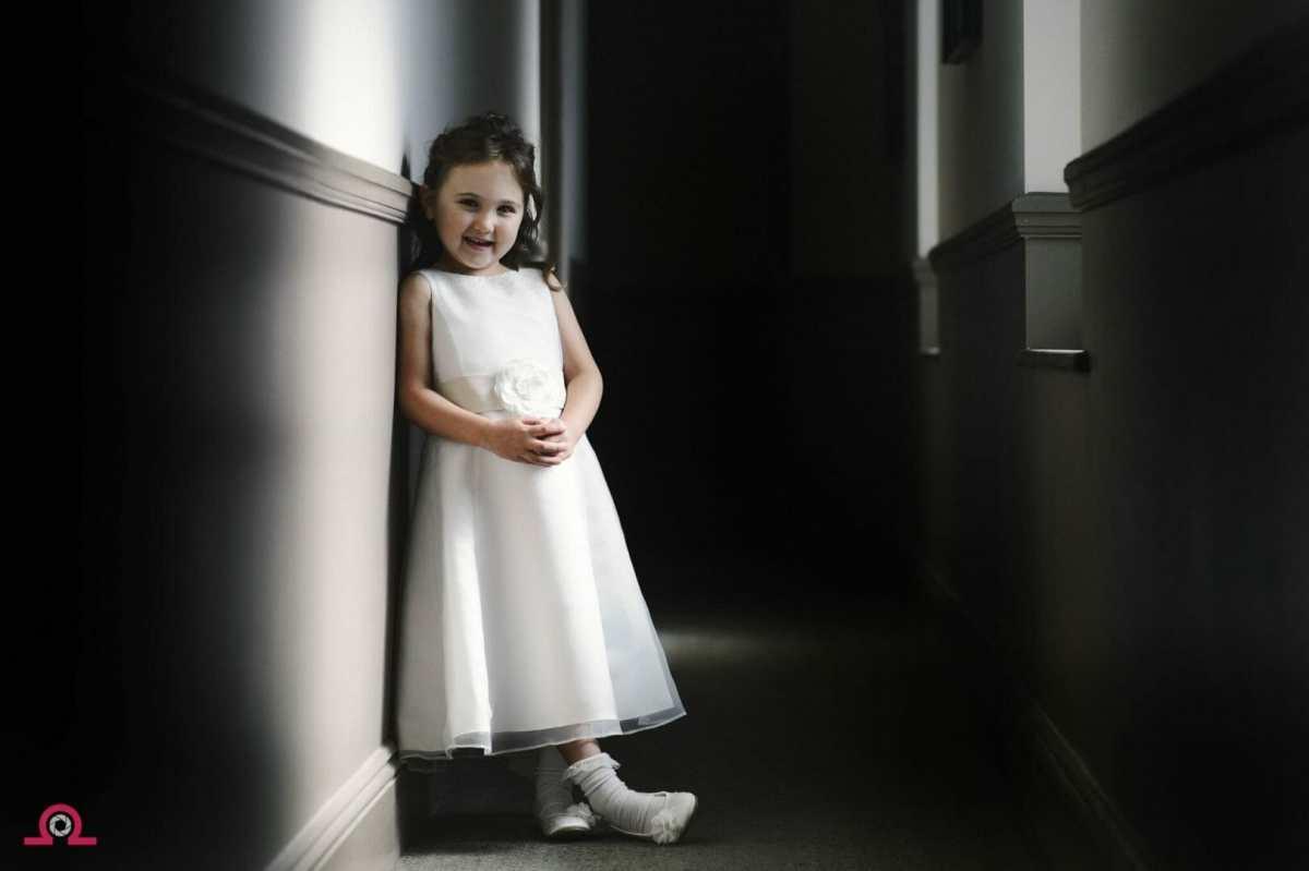 flowergirl waits by a hallway window in hotel Du Vin Poole