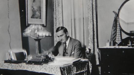 Arthur A. Wishart at a desk