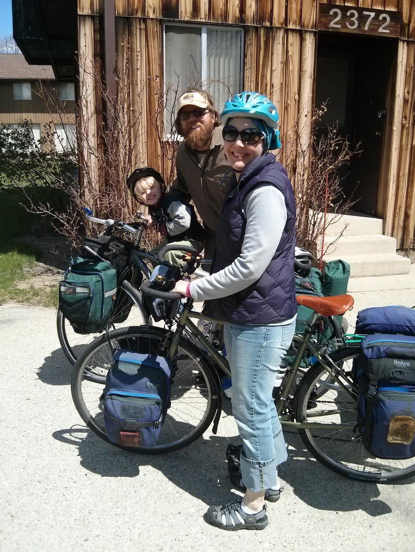 Image of Cinda, her husband, and son bike riding.