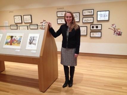 Curator Jenny Robb among Bill Watterson's original art