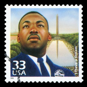 UNITED STATES OF AMERICA - CIRCA 1999: Stamp printed in USA dedicated to celebrate the century 1960s, shows Martin Luther King, circa 1999