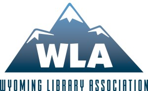 Wyoming Library Association logo has WLA on background of mountains and full name beneath