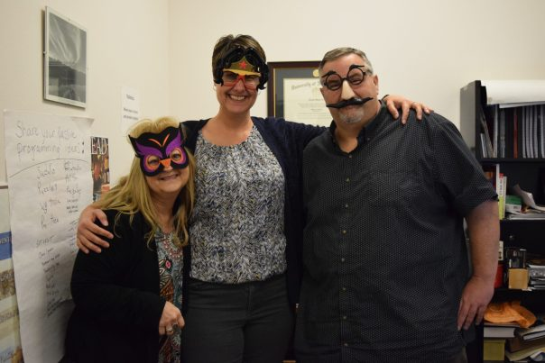 Chris, Paige, and Thomas standing together wearing funny glasses