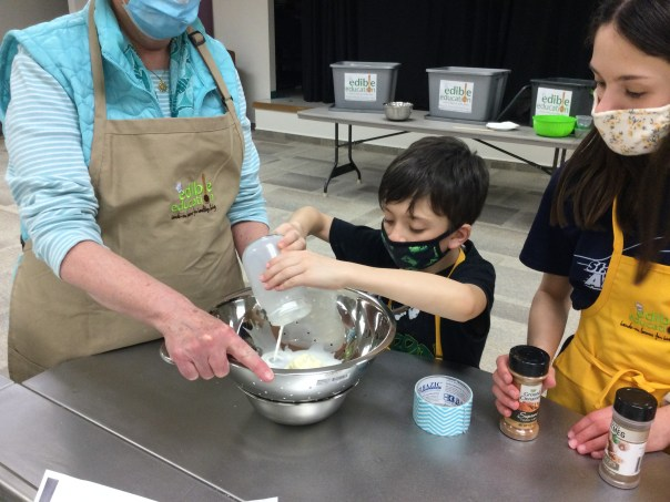 Young boy and slightly older girl mixing ingredients in bowl