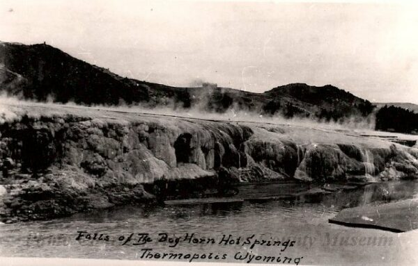 Old black and white postcard with photo of hot springs
