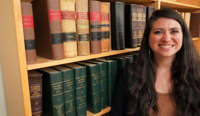 Sara Davis standing in front of bookshelf