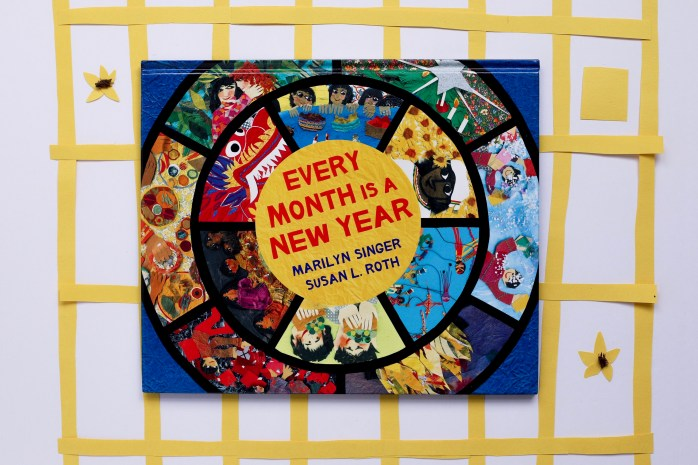 "A copy of the book ""Every Month is a New Year"" sits on top of a calendar made of collage."