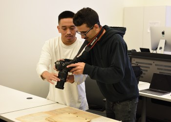 Students photographing documents