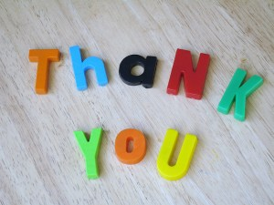 """Thank you"" spelled in colorful magnet letters"
