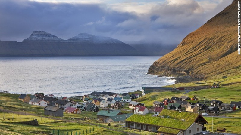 In the northeast corner of Eysturoy, Gjogv Village is home to less than 50 inhabitants. A lot of attention to preserving the traditional buildings of the Faroe with the main design is red, white and green.